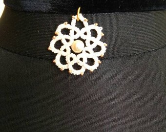 Needle tatting medallion on black velvet ribbon