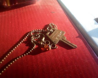 INSIGHT stamped key with charms