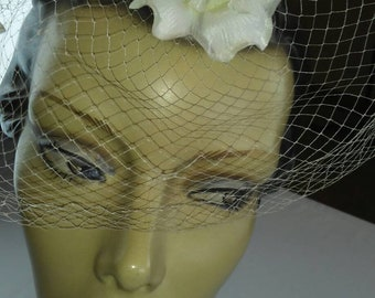 Vintage orchid flower hat with white netting