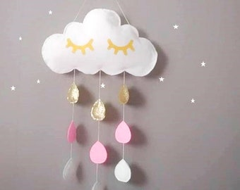 Glittery gold white cloud with eyelashes and her water drops