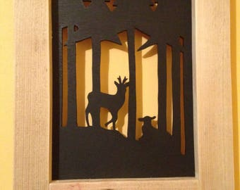 FRAME DEPICTING DEER IN FOREST