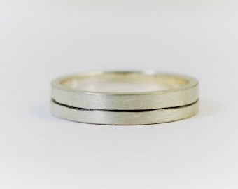 Theres a fine line .. ecosilver mans ring wedding style, oxidised central hand engraved line.