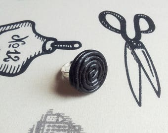 Roll of black licorice polymer clay ring