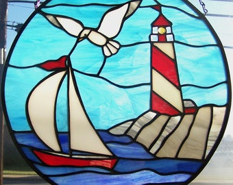 Lighthouse with sailboat