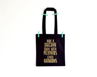 Black tote bag with print Ride a unicorn swim with mermaids chase rainbows