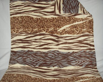 Pet Blanket - zebra leopard print with one large stripe of blue with the same pattern on the reverse side.
