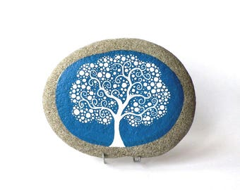 Painted Pebble, white tree, a blue background