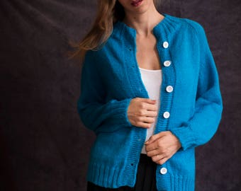 Cozy, warm, blue sweater hand knitted