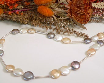 Freshwater Coin Pearls with Sterling Silver Findings.