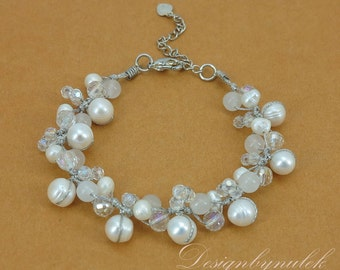 White freshwater pearl hand knotted on silk  bracelet.