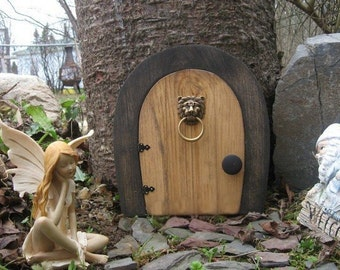 A Fairy door / Gnome door that OPENS.  9 inch rounded Gnome / Fairy door with lion knock.