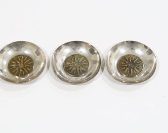 3 unique sterling silver bowls with an armor like pattern in the center