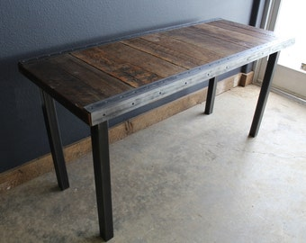 Industrial desk with raw steel trim and straight steel legs