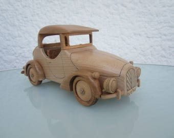 Wooden with a convertible car.