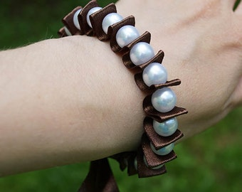 Bracelet with ribbons and beads. Brown ribbon, brown, white beads. Handmade.
