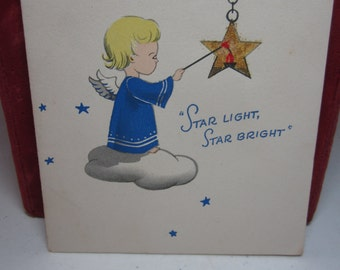 1940's-50's christmas card angel sits on cloud lighting a star with candle inside, star light star bright poem