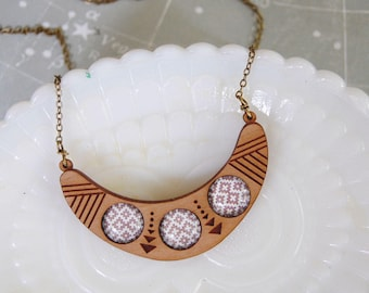 etched wood tribal style necklace with glass patterned cabochon detail
