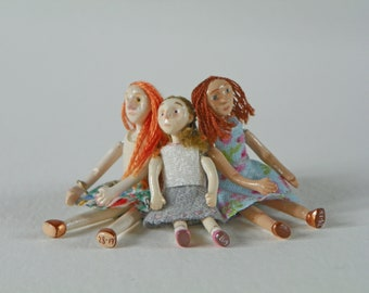 Set of three cute little dolls