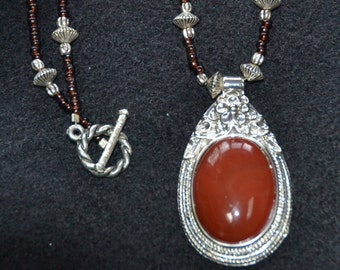 Red Agate Pendant Necklace set in Decorative Silver tone. Necklace of tiny deep Red and various silver beads. Great CHRISTMAS Gift.