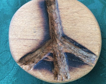 A Deep and Lasting Peace: Small carved maple peace sign