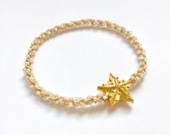 Stackable golden starfish charm bracelet