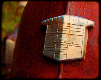 Rusty Cars - Garage Art - Automotive Art - Mr. Newman's Emblem - Rusty Old Car - Nash - Fine Art Photograph by Kelly Warren