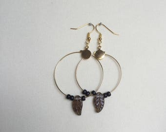 Gold earrings with black pearls and brown feather pearl