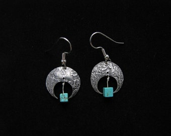 Domed, silver earrings with stone texture and turquoise cube