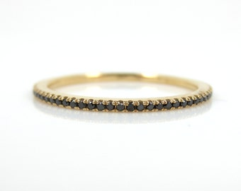 Micro Pave Black Diamond Eternity Band set in 18k Yellow Gold