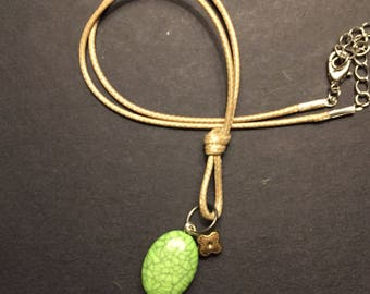 Green bead pendant brown cord necklace