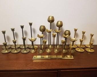 22 Ascending Brass Candlesticks & 1 Candelabra