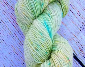 SUNDRESS colorway hand dyed yarn - Speckled yarn with green, turquoise, pink, and orange