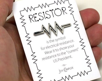 RESIST - soft enamel resistor pin.  Persist in your resistance!