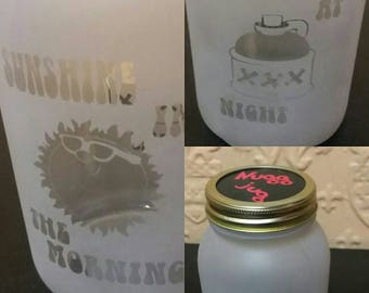 Mason jar Nugg jug sand carved with sunshine in the morning on the front moonshine at night on the back and the nugg jug logo on the cap