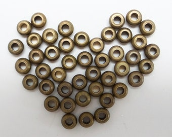 Vintage brass rondelle beads from Ethiopia. Old brass spacer beads. Price for 10 beads.  BB30