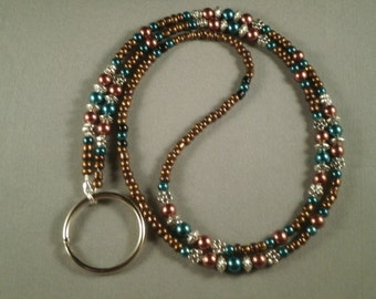 """teal and brown 26"""" to 42"""" plus attachment. key, ID or eyeglass lanyard, your choice attachmants:eyeglass ,key or ID holder"""