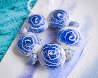 Blue white beads_big lentil shaped_lampwork glass_spiral pattern_dark electric blue_set of nine_18 mm_primitive symbols_multipurpose DIY kit