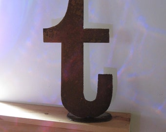 "15 inch tall lowercase metal letter ""t"" on stand"