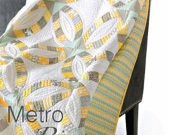 """Metro Rings by Sew Kind of Wonderful, measures approximately 57"""" x 76"""""""