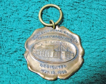 "Souvenir Advertising Watch Fob  Hartford CT Arsenal & Armory Watch Fob Dedicated On Nov. 12 1909 - 1 1/4"" X 1 1/4"" - Great Find!"