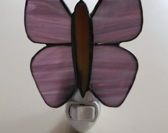 This Stained glass butterfly night light is made from beautiful purple glass w/ white wispy streaks that adds a soft glow to any room.