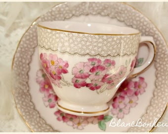 Tuscan, England: Pink tea cup & saucer with flowers