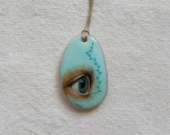 Necklace with hand-painted eye on pink quartz single piece