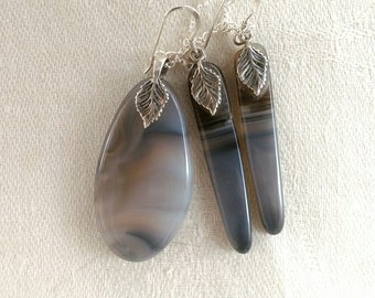 Blue agate and sterling silver earring and pendent set. Oval pendent and earring set. Black and grey jewelry.