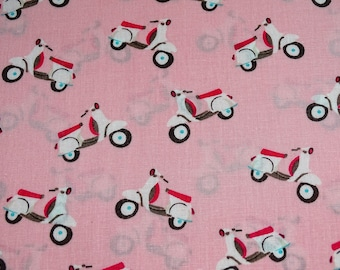 Patterns of pink scooter print cotton fabric