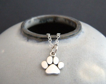 tiny silver paw print necklace. small sterling silver pet pride pendant. gift animal lover love charm simple pawprint dog cat jewelry 3/8""