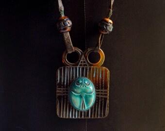 Vintage necklace, 1920s Egyptian Revival faux tortoiseshell pendant turquoise scarab, art deco, art nouveau, 35-inch leather cord, carved