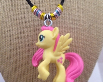 Fluttershy (My Little Pony) Mini Figure Character Necklace. Small figure on embellished leather cord necklace.