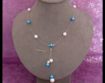 Necklace made of turquoise and white pearls