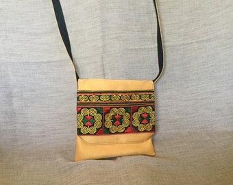 Embroidery and orange ethnic shoulder bag.